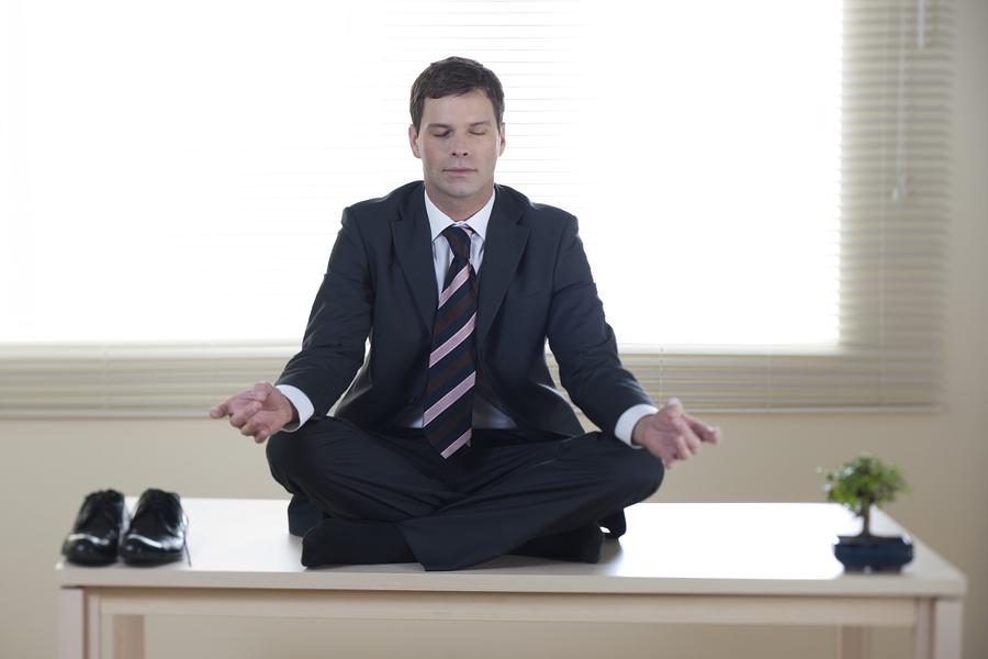 project-manager-meditating-on-desk