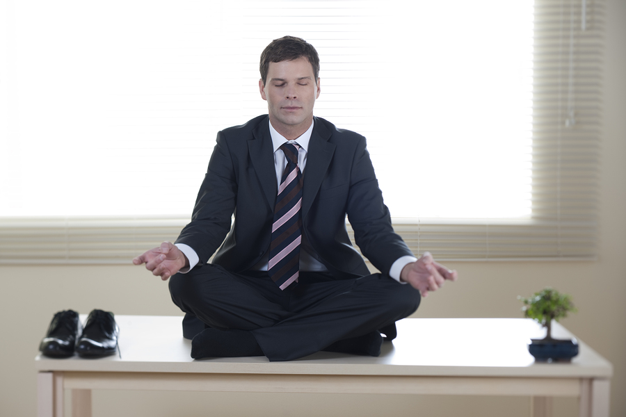 project-manager-meditating-on-desk